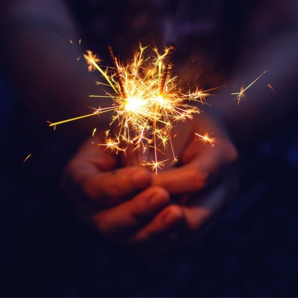 Hands Presenting a Spark